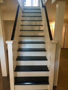 after madison woodland interior Custom Basement Staircase with Black Handrails