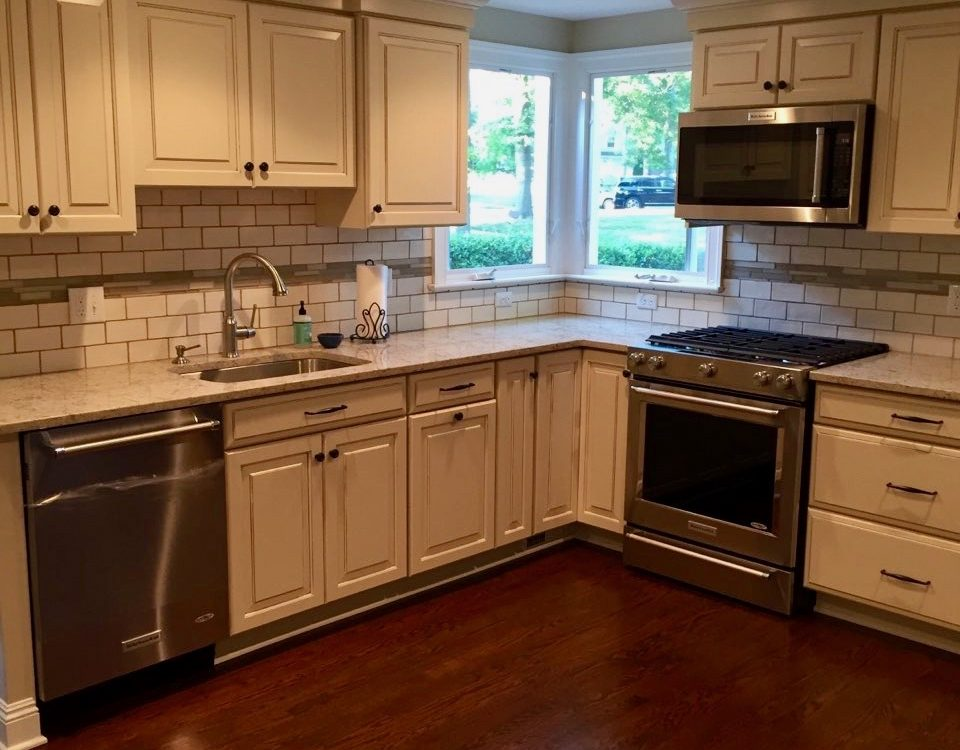 after pictures west orange mayfair Ivory Kitchen Cabinets with Black Cabinet Knobs and Black Drawer Bar Pulls