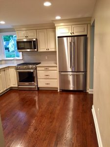 after pictures west orange mayfair Kitchen with Ivory Cabinetry Dark Hardwood Floors Stainless Steel Appliances