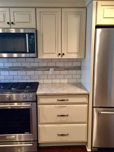 after pictures west orange mayfair Kitchen with Stainless Steel Appliances Granite Countertops Horizontal Subway Tile Backsplash