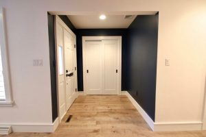 interior west orange 1 Front Entry Remodel 1 Panel Shaker Closet Doors with Black Hardware